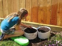 Economic Gardening - buried plastic paint drums