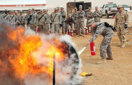 A soldier extinguishing a class A fire.