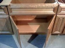 This is an example of European also known as frameless cabinets. Note there are no spaces between the doors or drawers.