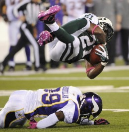 New York Jets' LaDainian Tomlinson flies over Minnesota Vikings' Husain Abdullah during the first quarter of an NFL football game between the Minnesota Vikings and the New York Jets Monday, Oct. 11, 2010, in East Rutherford, N.J. (AP Photo/Bill Kostr