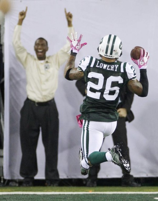 New York Jets' Dwight Lowery scores a touchdown after intercepting a pass late in the fourth quarter of an NFL football game against the Minnesota Vikings early Tuesday, Oct. 12, 2010, in East Rutherford, N.J. The Jets won 29-20. (AP Photo/Seth Wenig