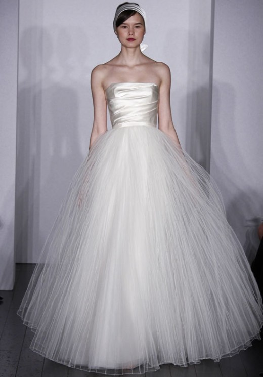 """A """"natural"""" waistline cuts the body in half and will make a short bride look smaller.  Photo: Amsale Bridal."""