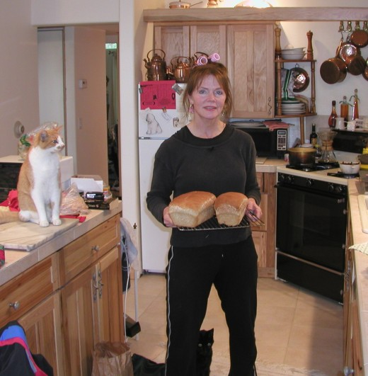 There is nothing like warm bread right out of the oven!  Please ignore the curlers...but NOT the cats!  This is the only pic I could locate w/me AND food.