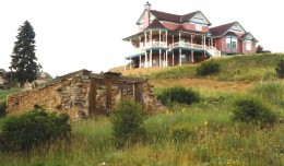 Very fancy house up on the hill and a ruin below it in Cripple Creek
