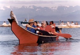 This is a Tlingit cedar dug out canoe that are still being made and used today. these are made from a single large log and are often used at sea as in this photo.