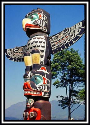This colorful totem pole is an example of west coast First Nations art. No two totem poles are the same, though themes do repeat, such as the eagle, the bear, the killer whale and the like.