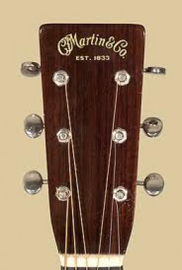 A common headstock of a Martin guitar, which is usually a very uncommon instrument of great value.