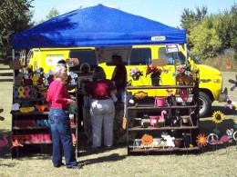 One of the busy vendors at the Monarch Festival had all kinds of yard decor, plants, butterfly related items.