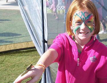 This young lady caught the huge grasshopper at an edge of the butterfly tent and displayed it for the camera.