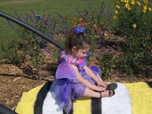 This darling purple butterfly shyly posed on Mr. Caterpillar while Daddy encouraged her.  She was a sweet  little butterfly.