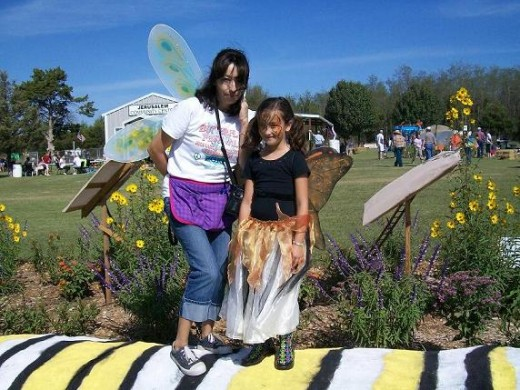 Happiness is being butterflies together and getting to pose on a caterpillar - especially at the wonderful Monarch Migration Celebration!