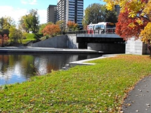 Leading to the Rideau Canal via the boat locks, note the city and the traffic over the bridge