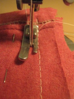 Line your first seam up against your presser foot and just follow the stitches down.  We do this so that if one seam opens up there is another one.  Do this on both of the J parts.