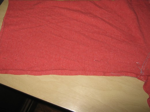 Match the edge of the fabric for the leg (the front side, with the backside) and pin.  Do this with the other leg too.