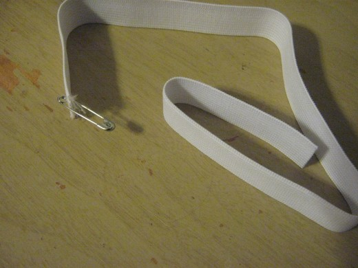 To thread your cord or elastic through the waist band attach a safety pin.
