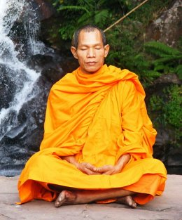 Meditation is a form of prayer. Buddhist monk in Phu Soidao Nationalpark, Phu Soidao Nationalpark Waterfall, Thailand, Uttaradit Province.