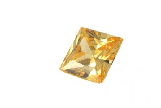 A princess cut yellow diamond.