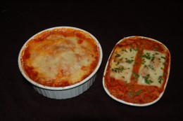 Ravioli covered with Cannelloni sauce & topped with Italian blend cheese on the left or Cannelloni topped with Mozzarella & topped with Italian Parsley on the right. Either way, your family wins!
