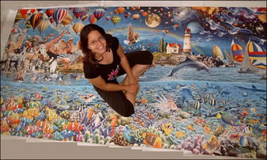 Annick Oriol from Belgium was the first to complete the world's largest jigsaw puzzle and it took her 28 days and 20 hours to finish it!