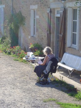 Student painting outside Les Trois Chenes