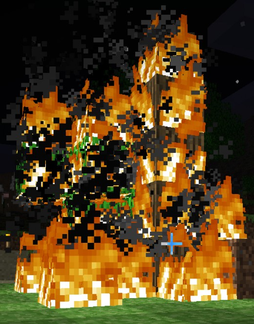 A tree in Miinecraft on fire.