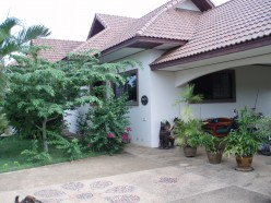 Front of the bungalow with carport.