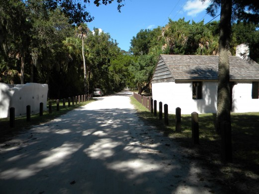Slave dwellings flank the road : Kingsley Plantation