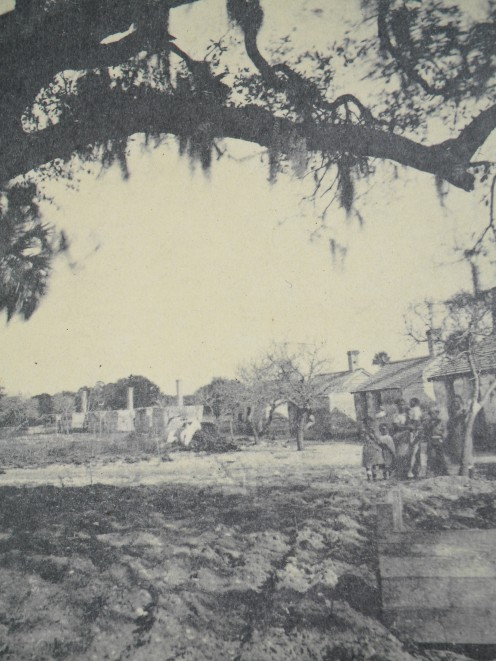 The same view of the slave quarters, occupied at the time.
