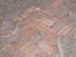 part of a brick paviered patio
