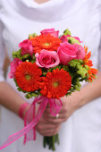The trend has been for brightly colored bridal bouquets.