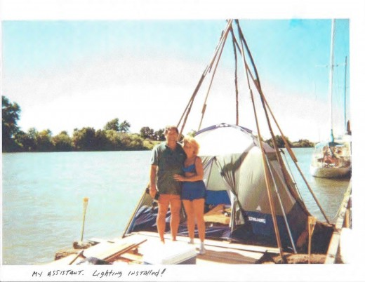 Teepee framework completed and secured to raft. With Tina, an adventure loving friend...