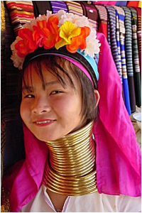 The Kayan women wear traditional, stacked metal neck rings that elongate their necks since age 5