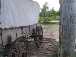 Covered wagon on a  corduroy road (1830s)