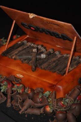The groom likes cigars--and his groom's cake is an edible cigar box! Photo courtesy of: weddingandpartynetwork.com