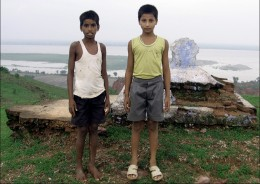 Two boys stand in front of the  grave of the unknown person . From the hill-top, I could see the view of the Ganges in the horizon. Notice the the split in the stream.