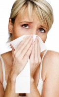 Woman trying to unblock her blocked nose