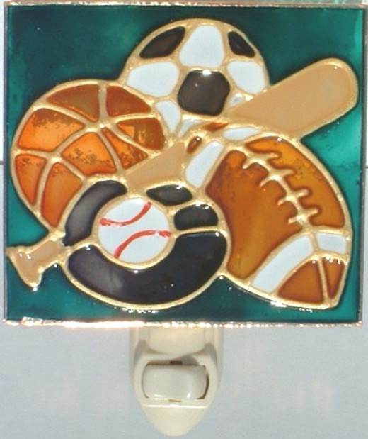 stained glass night light with sports theme - football, baseball and baseball bat, soccer, basketball