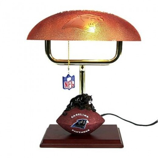 Product Features     * A great home accent for football fans     * Resin mascot on wood base with textured and embossed glass shade     * UL listed     * An official NFL logo dangles from the pull chain     * 14H""