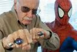 Lee posing with his most famous creation Spider Man