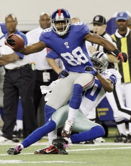 New York Giants wide receiver Hakeem Nicks is tackled by Dallas Cowboys cornerback Alan Ball during the first half of an NFL football game Monday, Oct. 25, 2010, in Arlington, Texas. (AP Photo/LM Otero)
