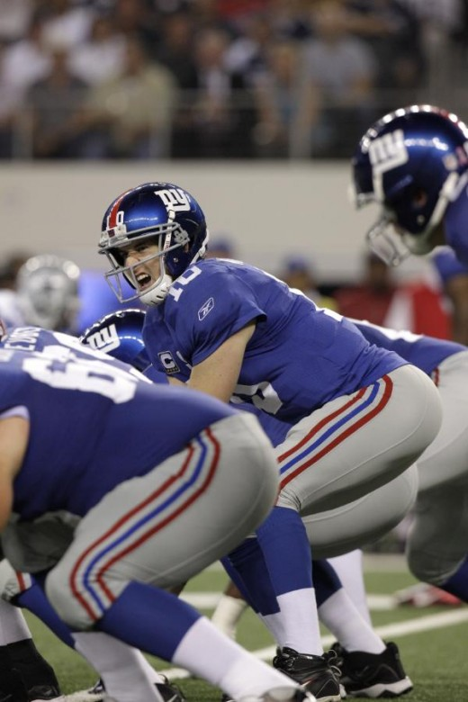 New York Giants' Eli Manning (10) duri ng an NFL football game against the Dallas Cowboys Monday, Oct. 25, 2010, in Arlington, Texas. (AP Photo/LM Otero)