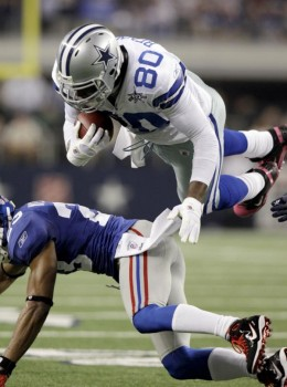 Dallas Cowboys tight end Martellus Bennett is upended by New York Giants cornerback Corey Webster during the first half of an NFL football game Monday, Oct. 25, 2010, in Arlington, Texas. (AP Photo/LM Otero)