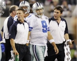 Dallas Cowboys quarterback Tony Romo leaves the field during the second quarter against the New York Giants in an NFL football game Monday, Oct. 25, 2010, in Arlington, Texas. Romo was drilled into the turf on his left shoulder, forcing him to the lo
