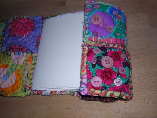 Fabric journal showing pages and fold-over flap.