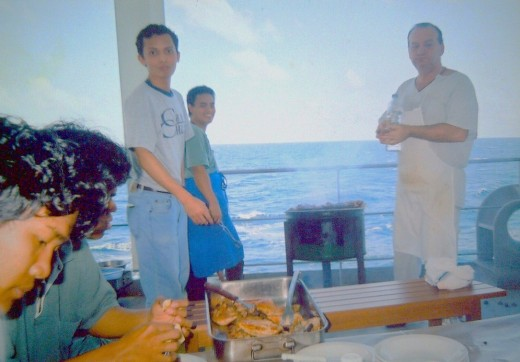 A typical Saturday barbecue party on board  ship (circa 2001) with my Greek chief cook and young-looking travel_man1971 (Ireno Alcala) while on voyage