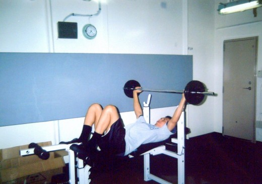 travel_man1971 doing a bench press at the ship's gym