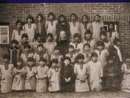 """Entitled """"Fallen Feather"""" this photo shows some of the thousands of children that were abducted well into the 20th century for assimilation."""