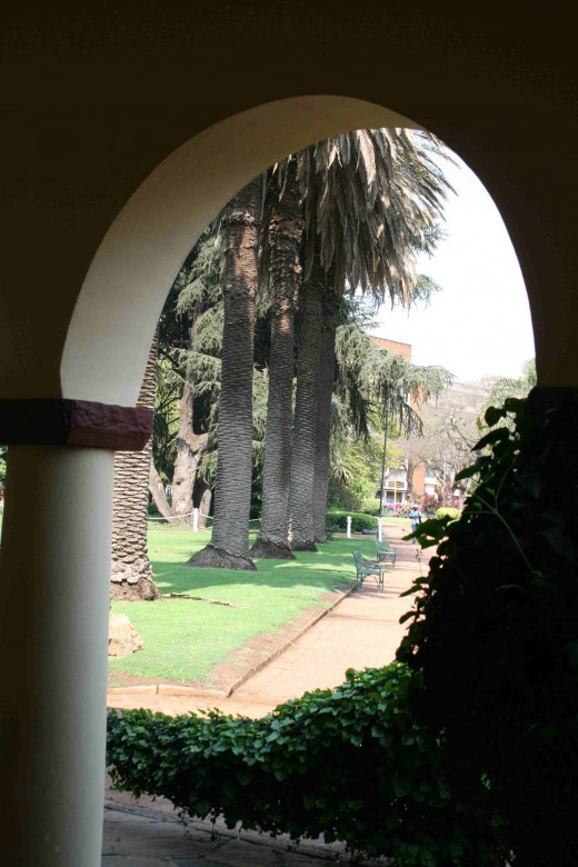 Looking through one of the arches of the pavilion at the park.