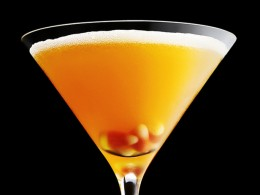 A candy corn garnish can be a great way to liven up a drink.