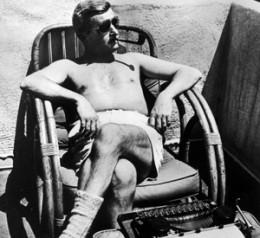 Faulkner enjoying the sun and his ubiquitous pipe.